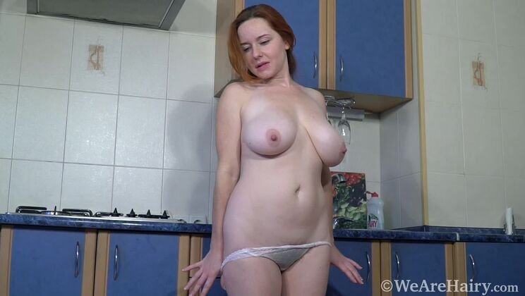 Elouisa strips naked in her blue kitchen