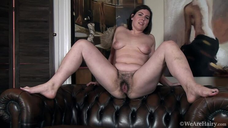 Sharlyn strips naked on her new leather couch
