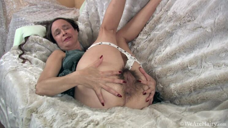 Josie strips naked and enjoys her hairy bush