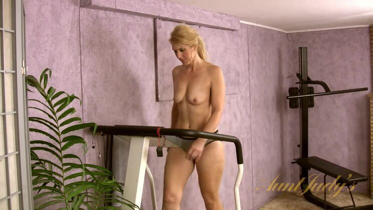 Trish exercises and gets naked.